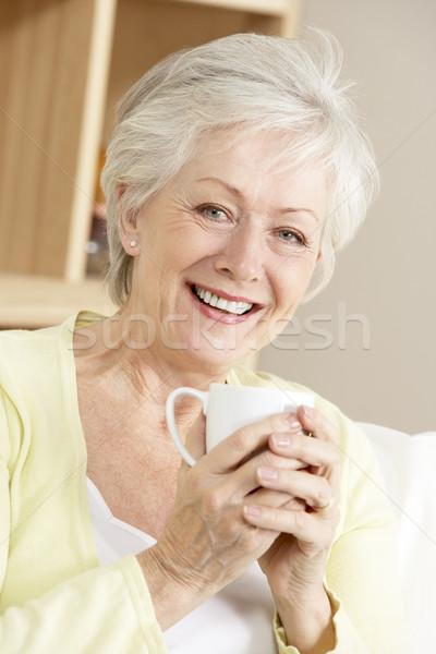 Senior donna bevanda calda home casa Foto d'archivio © monkey_business