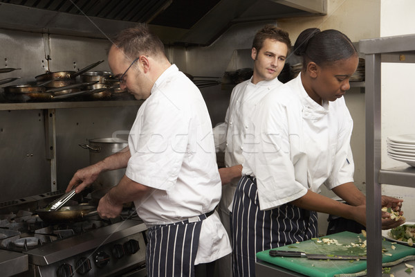 Team chefs restaurant keuken vrouw Stockfoto © monkey_business