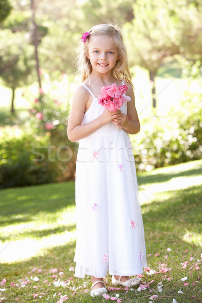 Portrait Of Bridesmaid Holding Bouquet Outdoors Stock photo © monkey_business