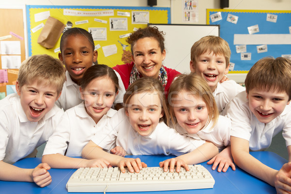 Schoolchildren in IT Class Using Computers with teacher Stock photo © monkey_business