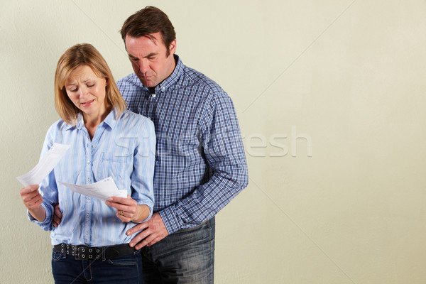 Studio Shot Of Middle Aged Couple Looking at Bills Stock photo © monkey_business