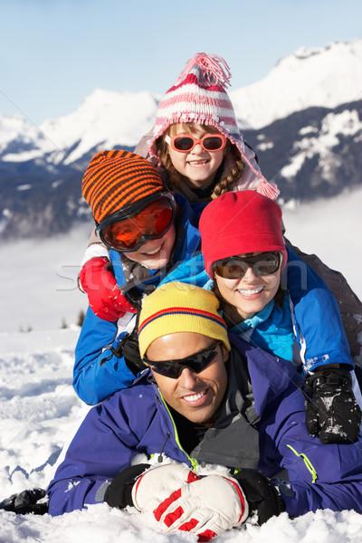 Family Having Fun On Ski Holiday In Mountains Stock photo © monkey_business