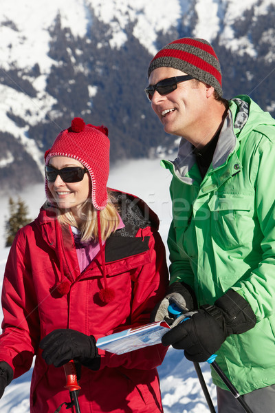 Couple Looking At Map Whilst On Ski Holiday In Mountains Stock photo © monkey_business