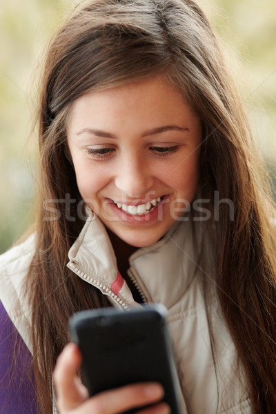 Teenage Girl Texting On Smartphone Wearing Winter Clothes Stock photo © monkey_business