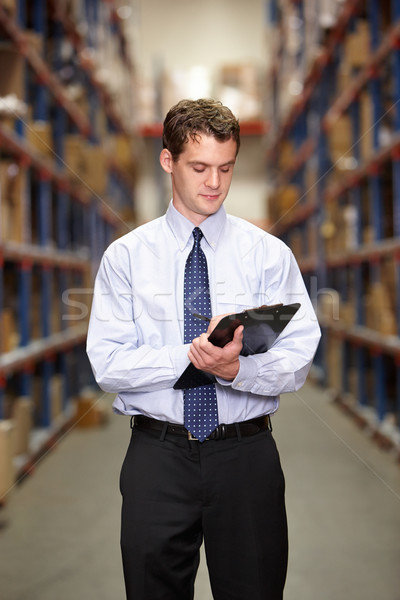 Manager In Warehouse With Clipboard Stock photo © monkey_business
