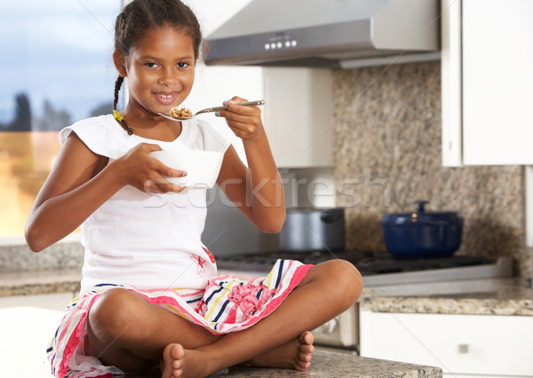 Girl In Kitchen Eating Bowl Of Breakfast Cereal Stock photo © monkey_business