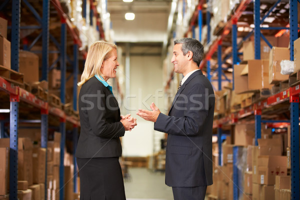 Businesswoman And Businessman In Distribution Warehouse Stock photo © monkey_business