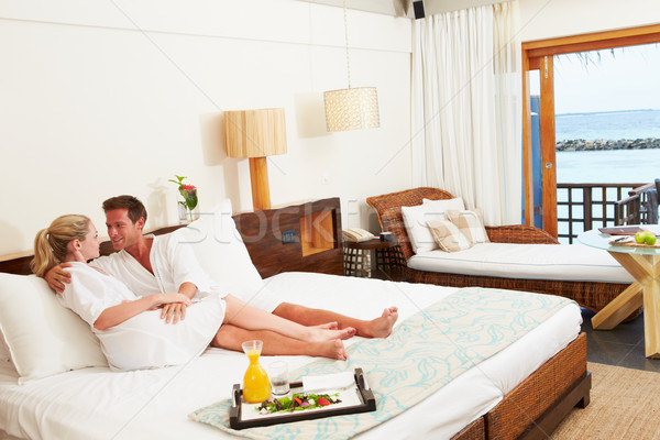 Couple Relaxing In Hotel Room Wearing Robes Stock photo © monkey_business