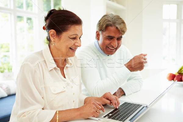 Senior Indian Couple Using Laptop At Home Stock photo © monkey_business