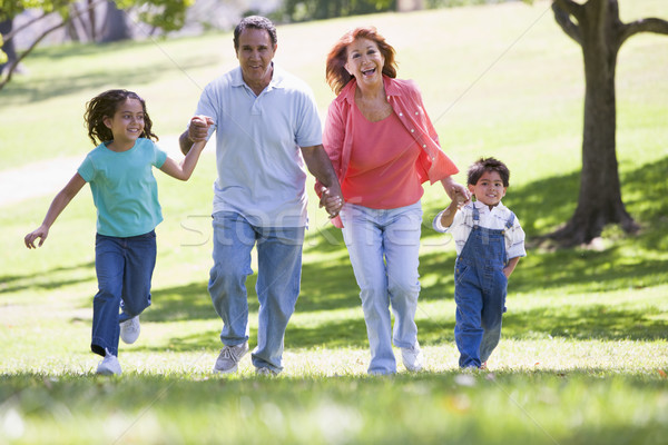 Grands-parents courir petits enfants famille fille couple Photo stock © monkey_business