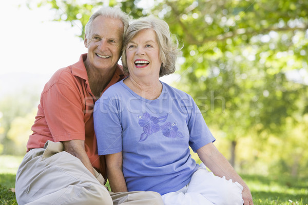 Stock photo: Senior couple relaxing in park
