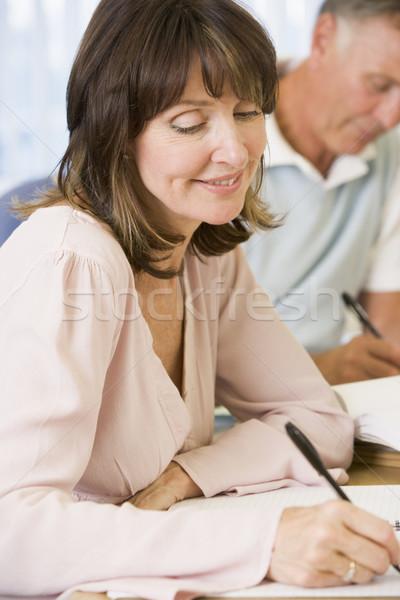 изучения другой взрослых студентов бумаги человека Сток-фото © monkey_business