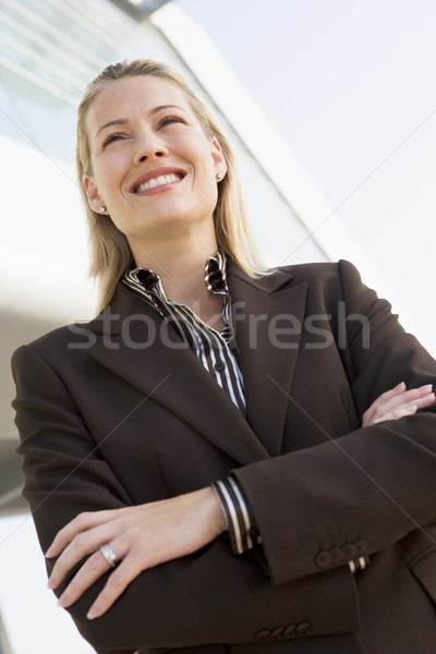 Businesswoman standing outdoors by building smiling Stock photo © monkey_business