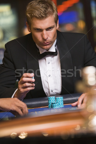 Man gambling at roulette table in casino Stock photo © monkey_business