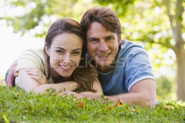 Couple lying outdoors smiling Stock photo © monkey_business