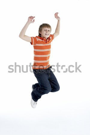 Young Boy Jumping In Air Stock photo © monkey_business