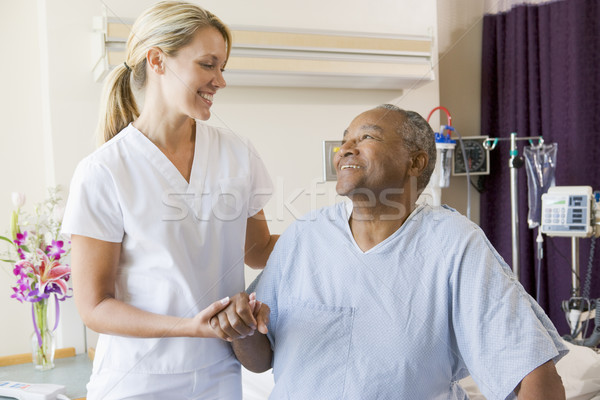 Nurse Helping Patient Sit Up In Bed Stock photo © monkey_business