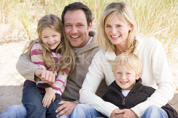 Stock photo: Family sitting on beach smiling