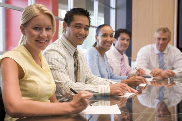 Five businesspeople in boardroom smiling Stock photo © monkey_business