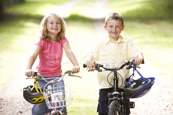 Children riding bikes in countryside Stock photo © monkey_business