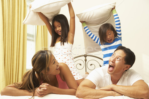 Young Family Having Pillow Fight In Bedroom Stock photo © monkey_business