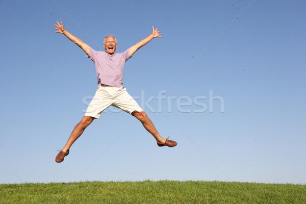 Senior man jumping in air Stock photo © monkey_business