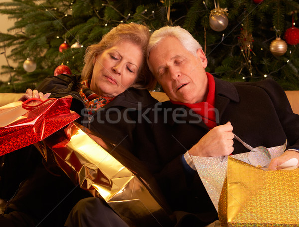 Tired Senior Couple Returning After Christmas Shopping Trip Stock photo © monkey_business
