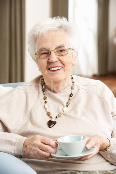 Senior Woman Enjoying Cup Of Tea At Home Stock photo © monkey_business