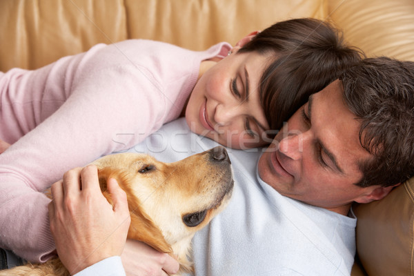 Portrait Of Couple Relaxing On Sofa With Pet Dog At Home Stock photo © monkey_business