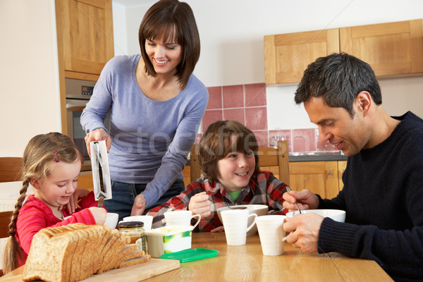 Family Eating Breakfast Together In Kitchen Stock photo © monkey_business
