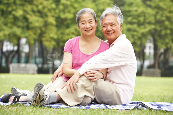 старший китайский пару расслабляющая парка вместе Сток-фото © monkey_business
