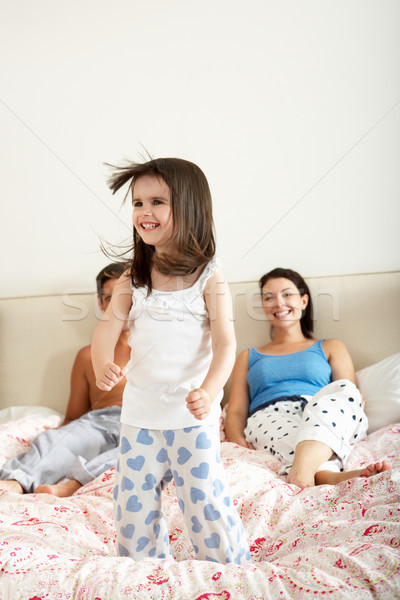 Family Bouncing On Bed Together Stock photo © monkey_business