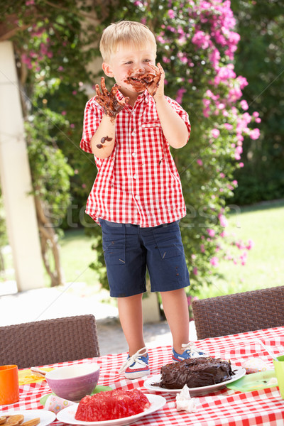 Boy Eating Jelly And Cake At Outdoor Tea Party Stock photo © monkey_business