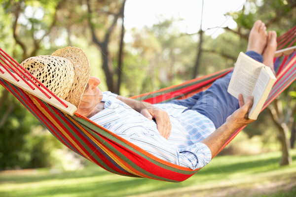 Senior Man Relaxing In Hammock With Book Stock photo © monkey_business