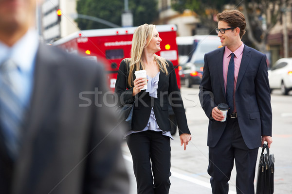 Businessman And Businesswoman In Street With Takeaway Coffee Stock photo © monkey_business