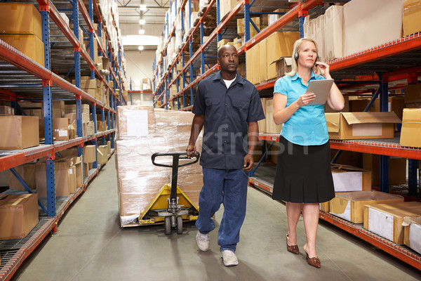 Businesswoman And Male Worker In Distribution Warehouse Stock photo © monkey_business