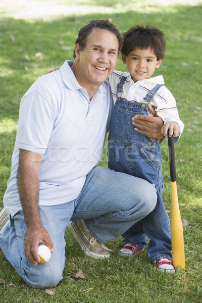 Grandfather and grandson holding baseball bat and smiling Stock photo © monkey_business