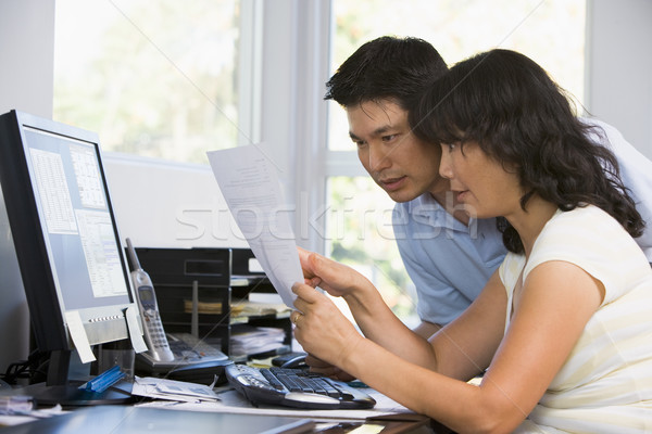 Couple in home office with computer and paperwork pointing Stock photo © monkey_business