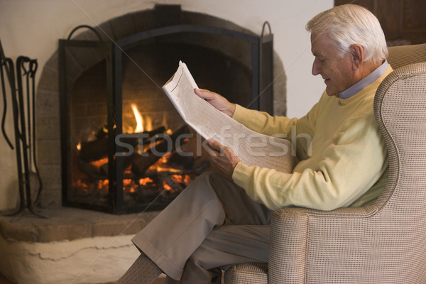 Man in living room reading newspaper Stock photo © monkey_business