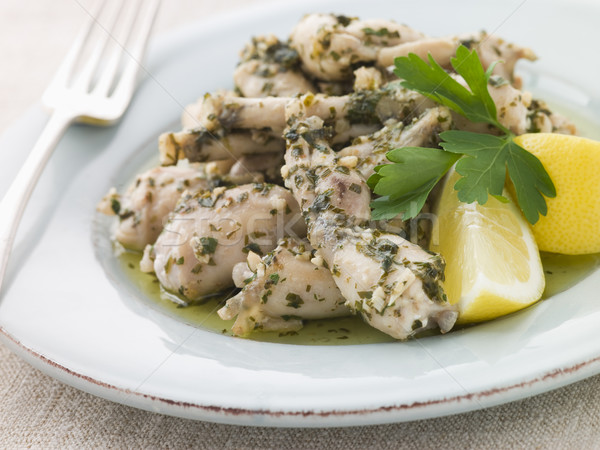 Frogs Legs Fried in Garlic and Herb Butter with Lemon Stock photo © monkey_business