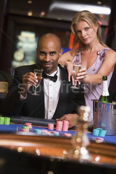 カップル ギャンブル ルーレット 表 カジノ 男 ストックフォト © monkey_business