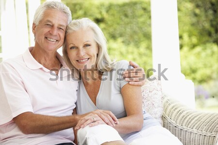 Husband giving wife gift in living room smiling Stock photo © monkey_business