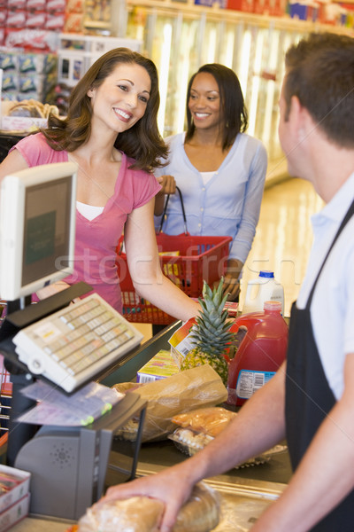 Woman paying for groceries Stock photo © monkey_business