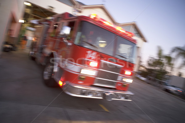 Fire engine rushing out of a fire station Stock photo © monkey_business