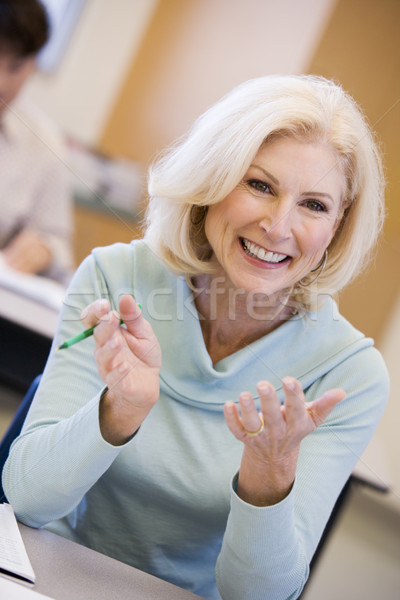 Mature female student gesturing in class Stock photo © monkey_business