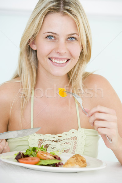 Saludable mujer casa comer Foto stock © monkey_business