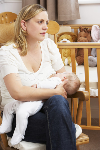 Worried Mother Breastfeeding Baby In Nursery Stock photo © monkey_business