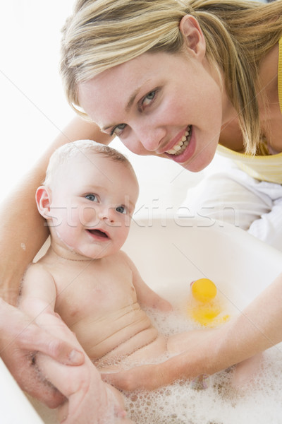 Mother giving baby bubble bath smiling Stock photo © monkey_business