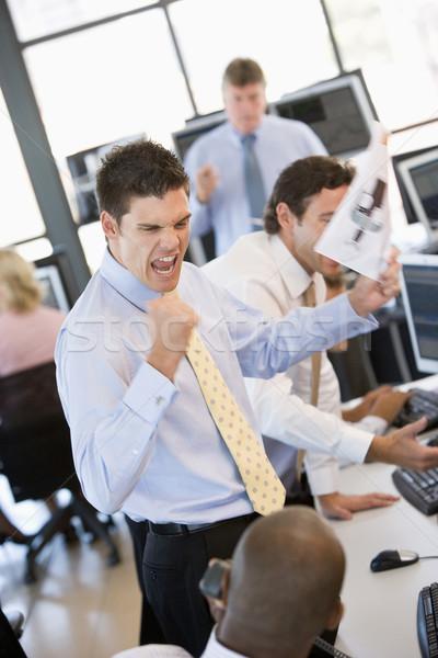 Stock commerciante felice successo ufficio imprenditore Foto d'archivio © monkey_business