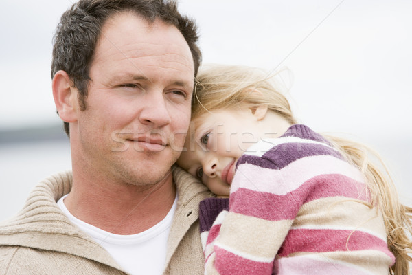 Father holding daughter at beach Stock photo © monkey_business